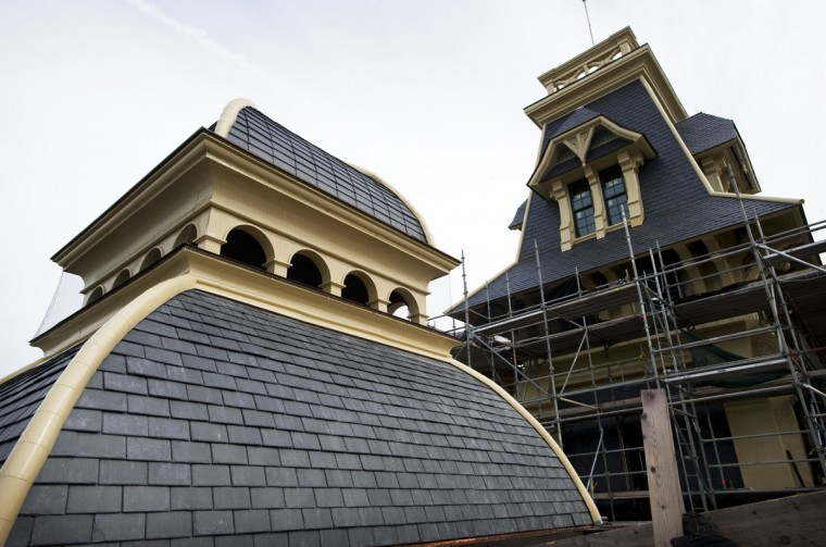 Restoration efforts of the American Brewery building are beginning to show on the roof of the building. New slate tiles, windows and and freshly painted trim are the easily visible aspects of the restoration. (Christopher T. Assaf /Baltimore[Sun