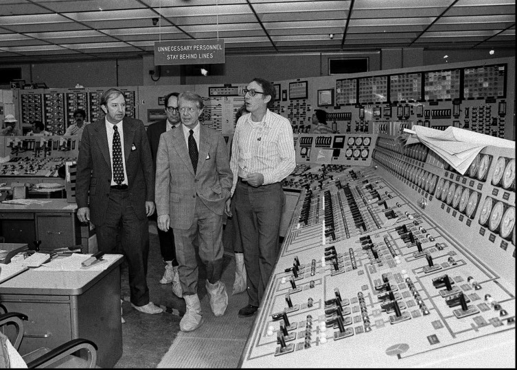 Wearing protective boots, President Carter, center right, accompanied by Dr. Harold Denton, then Director of the U.S. Nuclear Agency, left, and then Pennsylvania Gov. Dick Thornburg, left-rear, tour the control room of the Three Mile Island nuclear plant in Middletown, Pa. in this April 1, 1979 black-and-white file photo, four days after the nuclear accident. A quarter century after the country's worst nuclear accident, the atomic power industry is talking about revival. Yet no one can predict when a new reactor will be built and perceptions about safety. (AP Photo, Files)