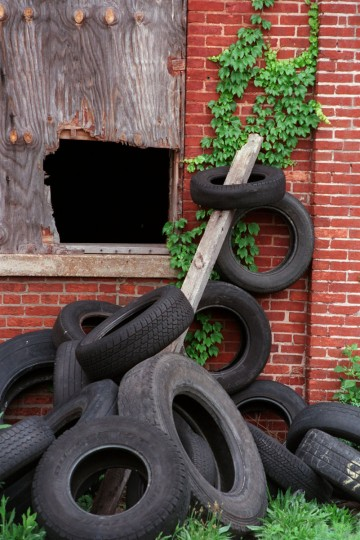 The site of the vacant American Brewery on Gay Street, has become a scrap tire dump, which has concerned the Maryland Department of the Environment. (Linda Coan/Baltimore Sun)