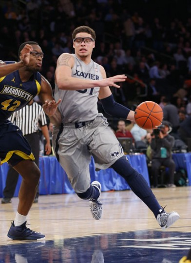 Isaiah Philmore's 12th-seeded Xavier squad faces 12th-seeded N.C. State on Tuesday in a play-in game in Dayton, Ohio. The winner plays fifth-seeded St. Louis on Thursday in Orlando. Philmore is a senior forward for the Musketeers and a John Carroll graduate. (Jim O'Connor-USA TODAY Sports)
