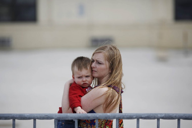 Army wife Stephanie Frutig holds her son Abram Frutig, 1, as she awaits the arrival of her husband Sgt. Austin Frutig of the U.S. Army's Battery B, 2nd Battalion, 44th Air Defense Artillery Regiment, 101st Airborne Division, before a homecoming ceremony at Campbell Army Airfield March 21, 2014 in Fort Campbell, Kentucky. About 60 soldiers returned to Fort Campbell after a nine-month combat deployment providing artillery and mortar support for coalition forces in Afghanistan. (Luke Sharrett/Getty Images)