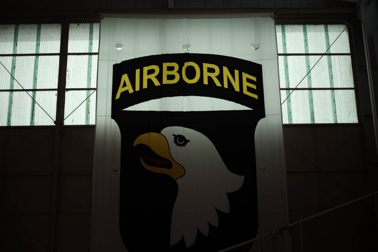 A banner bearing the Screaming Eagle insignia of the 101st Airborne Division hangs in a hangar at Campbell Army Airfield March 21, 2014 in Fort Campbell, Kentucky. About 60 soldiers returned to Fort Campbell after a nine-month combat deployment providing artillery and mortar support for coalition forces in Afghanistan. (Luke Sharrett/Getty Images)