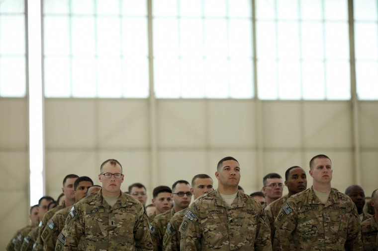 Soldiers from the U.S. Army's Battery B, 2nd Battalion, 44th Air Defense Artillery Regiment, 101st Airborne Division, stand at attention during a homecoming ceremony at Campbell Army Airfield March 21, 2014 in Fort Campbell, Kentucky. About 60 soldiers returned to Fort Campbell after a nine-month combat deployment providing artillery and mortar support for coalition forces in Afghanistan. (Luke Sharrett/Getty Images)