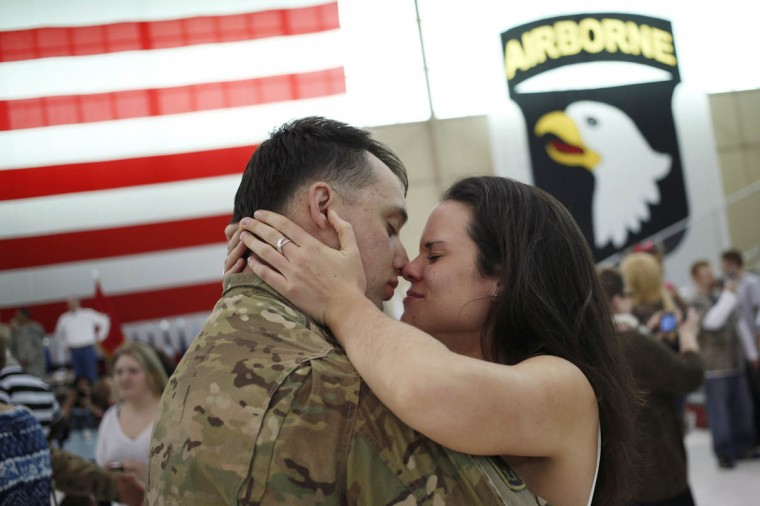 Sgt. Johnathan Link of the U.S. Army's Battery B, 2nd Battalion, 44th Air Defense Artillery Regiment, 101st Airborne Division, embraces his girlfriend Christine following a homecoming ceremony at Campbell Army Airfield March 21, 2014 in Fort Campbell, Kentucky. About 60 soldiers returned to Fort Campbell after a nine-month combat deployment providing artillery and mortar support for coalition forces in Afghanistan. (Luke Sharrett/Getty Images)