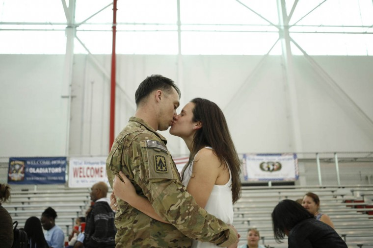 Sgt. Johnathan Link of the U.S. Army's Battery B, 2nd Battalion, 44th Air Defense Artillery Regiment, 101st Airborne Division, kisses his girlfriend Christine following a homecoming ceremony at Campbell Army Airfield March 21, 2014 in Fort Campbell, Kentucky. About 60 soldiers returned to Fort Campbell after a nine-month combat deployment providing artillery and mortar support for coalition forces in Afghanistan. (Luke Sharrett/Getty Images)