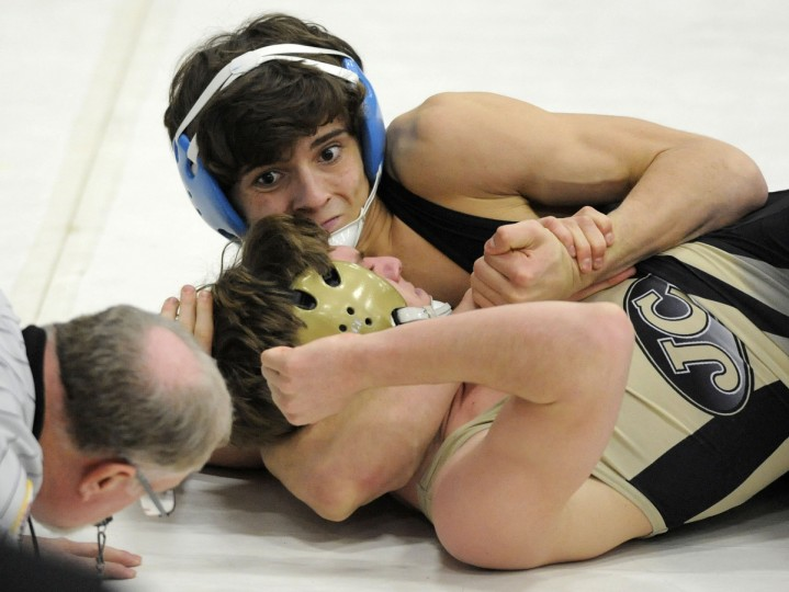 Huntingtown's Dominic Sita, top, works his way to a pin against John Carroll's Phillip Venanzi in the 145-pound final of the C. Milton Wright Iron Horse Duals in Bel Air. (Steve Ruark/for The Baltimore Sun)