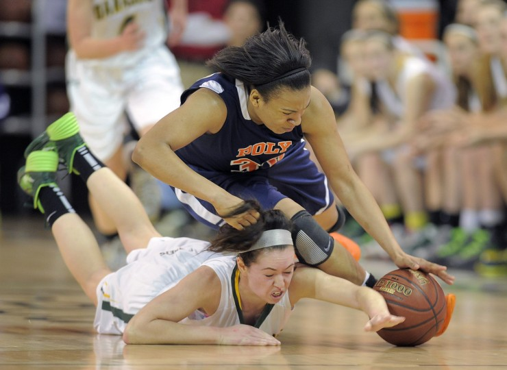 Poly's Teira Pendleton bounces on top of Damascus' Anna Warfield as they scramble for a loose ball, with Warfield getting injured on the play. (Karl Merton Ferron/Baltimore Sun)