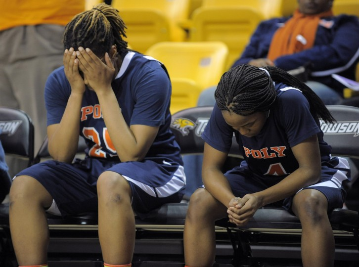 Poly's Morgan Newton (25) and Jasmine Smith (4) sit on the bench after the Engineers' loss to Damascus during the Class 3A Semifinals at Towson University. (Karl Merton Ferron/Baltimore Sun)