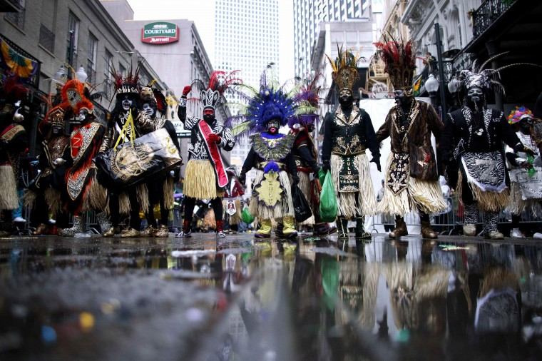 Members of the Krewe of Zulu parade down St. Charles Avenue on Mardi Gras Day in New Orleans, Louisiana March 4, 2014. (REUTERS/Jonathan Bachman)