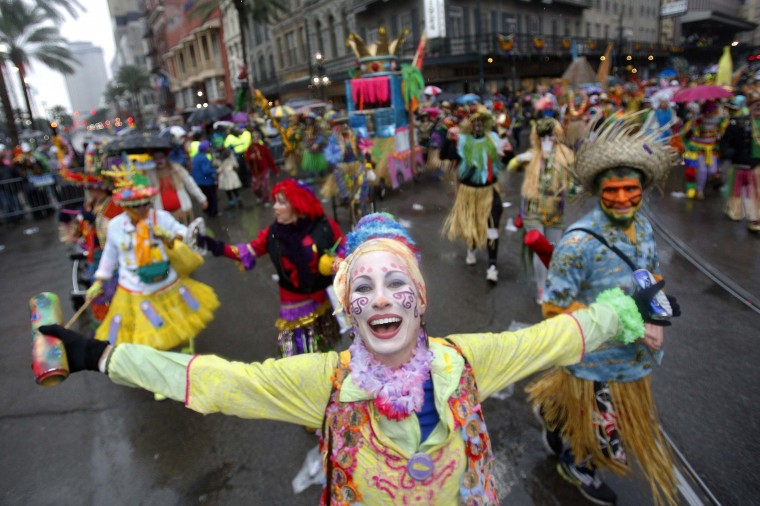 Members of the Mondo Kayo Social and Marching Club parade down St. Charles Avenue on Mardi Gras Day in New Orleans, Louisiana March 4, 2014. (REUTERS/Jonathan Bachman)