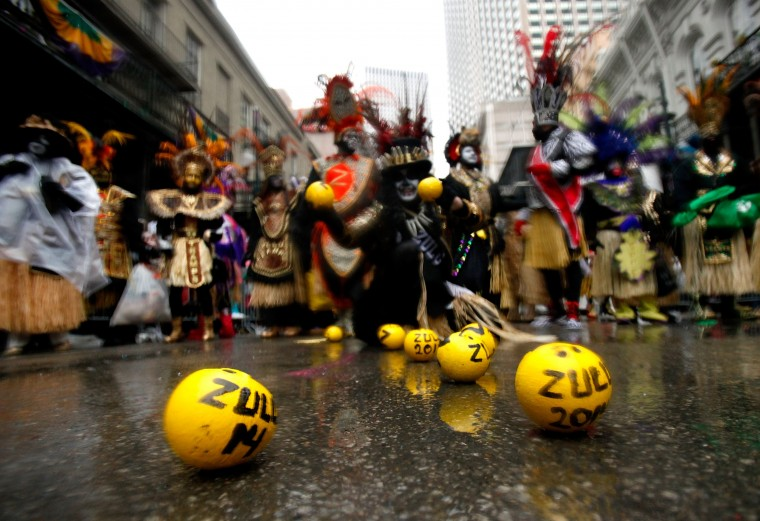 Members of the Krewe of Zulu pardes despite their rain Mardi Gras day on March 4, 2014 in New Orleans, Louisiana. Fat Tuesday, the traditional celebration on the day before Ash Wednesday and the beginning of Lent, is marked in New Orleans with parades and marches through many neighborhoods in the city. (Photo by Sean Gardner/Getty Images)