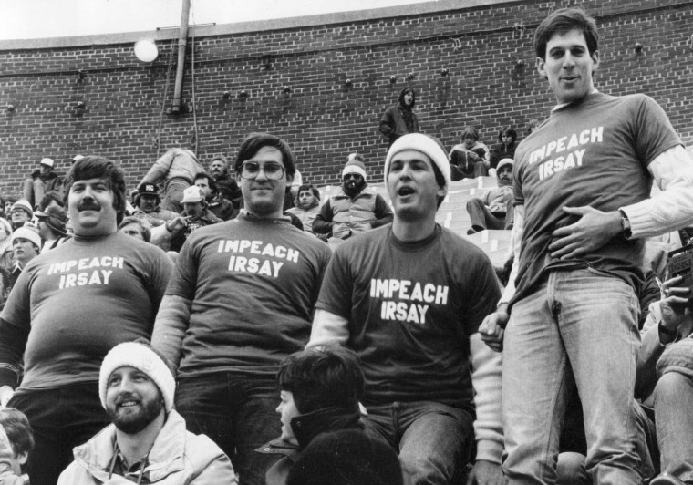 "At a Colts game in November, 1981, left to right: Dennis King, Lewis Goodman, Ken Meltzer, Alan Rifkin wear ""Impeach Irsay"" shirts. (Walter M. McCardell/Baltimore Sun)"