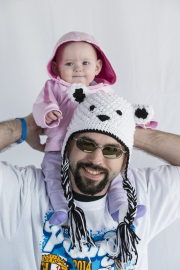 Daniel Kimball holds his nine-month-old daughter Lizabeth as they attend the Polar Bear Plunge.(Matthew Paul D'Agostino/For The Baltimore Sun)
