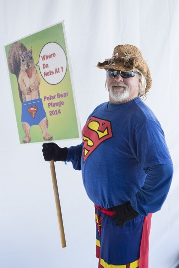 John Dubiel, with sign, at the Polar Bear Plunge. (Matthew Paul D'Agostino/For The Baltimore Sun)