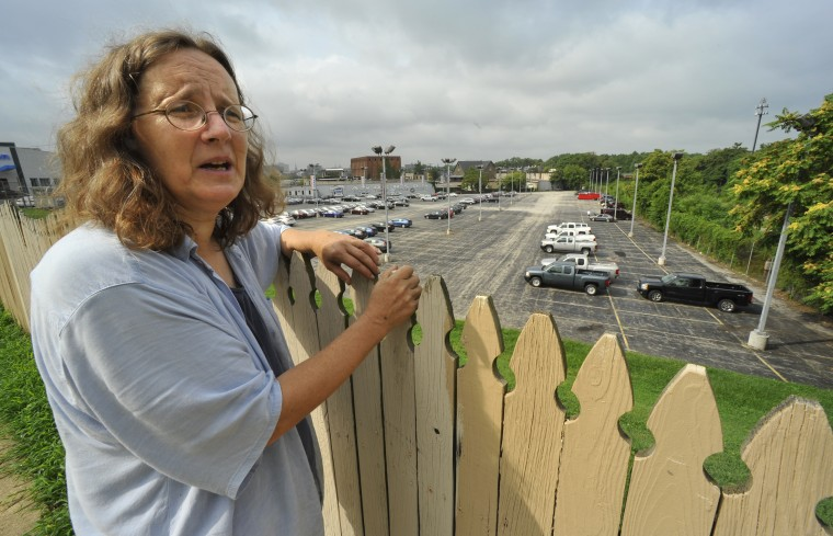 Joan Floyd, a Remington resident for about 15 years, looks over the fence in the 2500 block of Huntingdon Avenue, where a Walmart and Lowe's will be built. Floyd, one of the founding directors of the Remington Neighborhood Alliance, is concerned about traffic patterns and other impacts on the residents. Various Remington neighborhood groups have differing views on the huge development plans for their neighborhood, and how they can influence the outcome. (Amy Davis/Baltimore Sun/August 4, 2010)