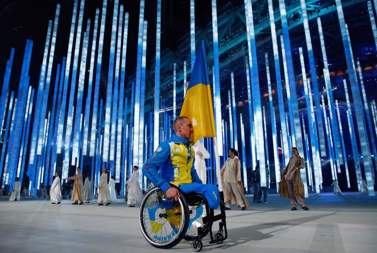 Flag bearer Mykailo Tkachenko of the Ukraine enters the arena during the Opening Ceremony of the Sochi 2014 Paralympic Winter Games at Fisht Olympic Stadium on March 7, 2014 in Sochi, Russia. The rest of the Ukraine team refused to enter the arena as a protest against the present political tension between Ukraine and Russia. (Tom Pennington/Getty Images)