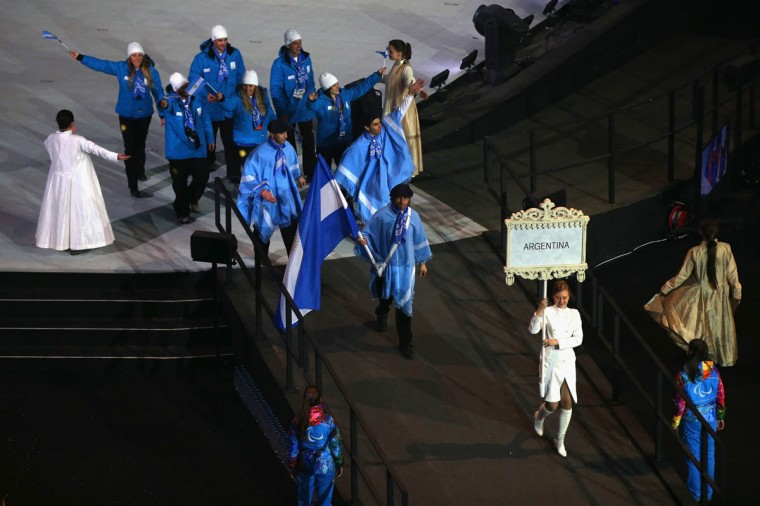 Nordic skier Pablo Javier Robledo of Argentina bears the flag during the Opening Ceremony of the Sochi 2014 Paralympic Winter Games at Fisht Olympic Stadium on March 7, 2014 in Sochi, Russia. (Hannah Peters/Getty Images)