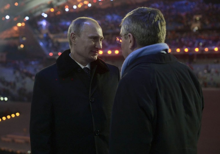Russia's President Vladimir Putin (Left) talks to International Olympic Committee (IOC) President Thomas Bach after the opening ceremony of the 2014 Paralympic Winter Games in Sochi, March 7, 2014. (Alexei Nikolsky/Reuters photo)