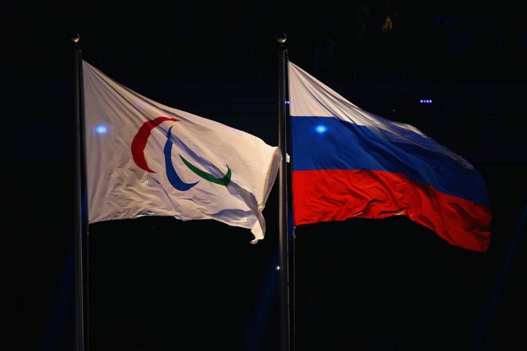 The Paralympic flag flies next to the Russia flag during the Opening Ceremony of the Sochi 2014 Paralympic Winter Games at Fisht Olympic Stadium on March 7, 2014 in Sochi, Russia. (Hannah Peters/Getty Images)