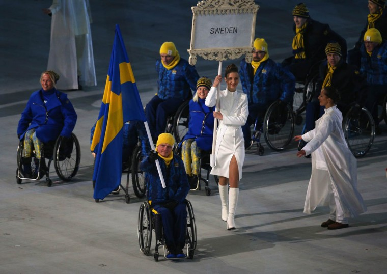Jalle Jungnell of Sweden bears a flag during the Opening Ceremony of the Sochi 2014 Paralympic Winter Games at Fisht Olympic Stadium on March 7, 2014 in Sochi, Russia. (Hannah Peters/Getty Images)