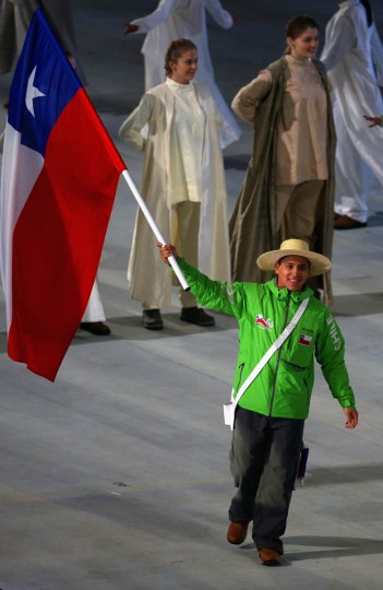 Jorge Migueles of Chile carries the flag during the Opening Ceremony of the Sochi 2014 Paralympic Winter Games at Fisht Olympic Stadium on March 7, 2014 in Sochi, Russia. (Hannah Peters/Getty Images)