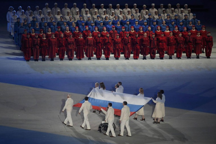 Russian athletes carry the Paralympic flag during the opening ceremony of the 2014 Paralympic Winter Games in Sochi March 7, 2014. (Christian Hartmann/Reuters photo)
