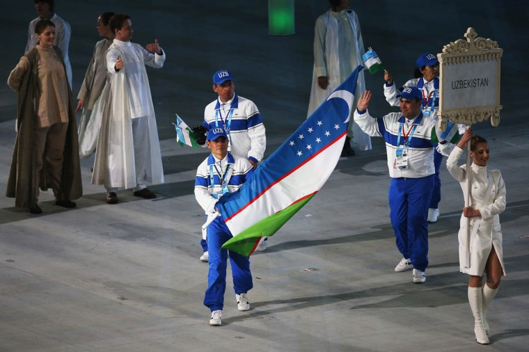 Ramil Gayazov of Uzbekistan carries the flag during the Opening Ceremony of the Sochi 2014 Paralympic Winter Games at Fisht Olympic Stadium on March 7, 2014 in Sochi, Russia. (Hannah Peters/Getty Images)