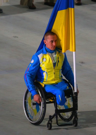 Mykailo Tkachenko of Ukraine bears the flag during the Opening Ceremony of the Sochi 2014 Paralympic Winter Games at Fisht Olympic Stadium on March 7, 2014 in Sochi, Russia. (Hannah Peters/Getty Images)