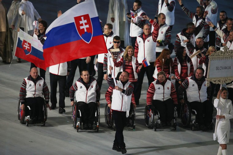 Jakub Krako of Slovakia carries the flag during the Opening Ceremony of the Sochi 2014 Paralympic Winter Games at Fisht Olympic Stadium on March 7, 2014 in Sochi, Russia. (Hannah Peters/Getty Images)