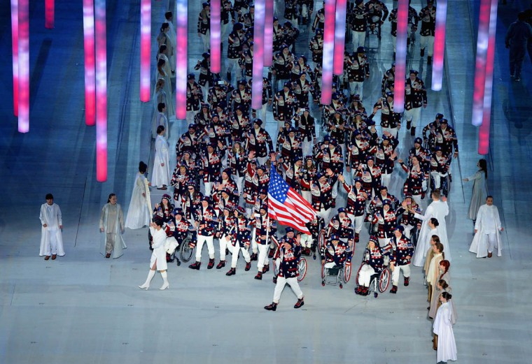 Jonathan Lujan of United States carries the flag during the Opening Ceremony of the Sochi 2014 Paralympic Winter Games at Fisht Olympic Stadium on March 7, 2014 in Sochi, Russia. (Dennis Grombkowski/Getty Images)