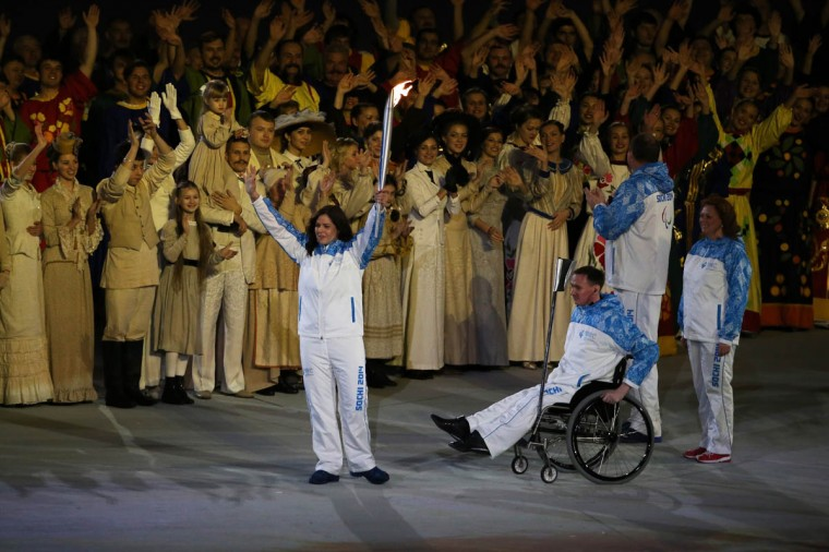 Torch bearers carry the flame into the arena during the Opening Ceremony of the Sochi 2014 Paralympic Winter Games at Fisht Olympic Stadium on March 7, 2014 in Sochi, Russia. (Ian Walton/Getty Images)