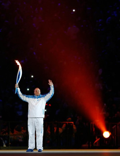 Paralympic torchbearer Aleksey Ashapatov enters the stadium during the Opening Ceremony of the Sochi 2014 Paralympic Winter Games at Fisht Olympic Stadium on March 7, 2014 in Sochi, Russia. (Tom Pennington/Getty Images)