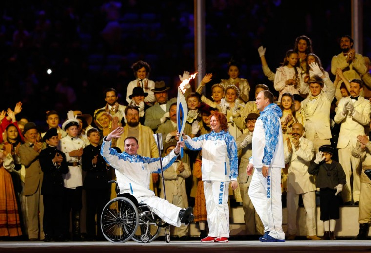 Paralympic torch bearers wave to the crowd during the Opening Ceremony of the Sochi 2014 Paralympic Winter Games at Fisht Olympic Stadium on March 7, 2014 in Sochi, Russia. (Tom Pennington/Getty Images)