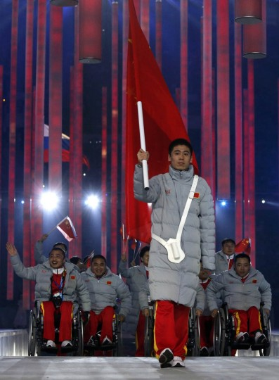 China's flag-bearer Tian Ye (Center), leads his country's contingent during the opening ceremony of the 2014 Paralympic Winter Games in Sochi, March 7, 2014. (Alexander Demianchuk/Reuters photo)