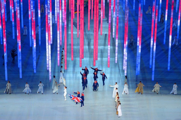 Alpine skier Millie Knight of Great Britain bears the flag during the Opening Ceremony of the Sochi 2014 Paralympic Winter Games at Fisht Olympic Stadium on March 7, 2014 in Sochi, Russia. (Dennis Grombkowski/Getty Images)