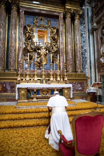 Newly elected Pope Francis I, Cardinal Jorge Mario Bergoglio of Argentina, prays before an icon of Mary during a private visit to the 5th-century Basilica of Santa Maria Maggiore, in a photo released by Osservatore Romano in Rome March 14, 2013. Pope Francis, barely 12 hours after his election, quietly left the Vatican early on Thursday to pray for guidance as he looks to usher a Roman Catholic Church mired in intrigue and scandal into a new age of simplicity and humility. The Pope prayed before a famed icon of Mary, the mother of Jesus, which is known as the Salus Populi Romani, or Protectress of the Roman People. (REUTERS/Osservatore Romano )