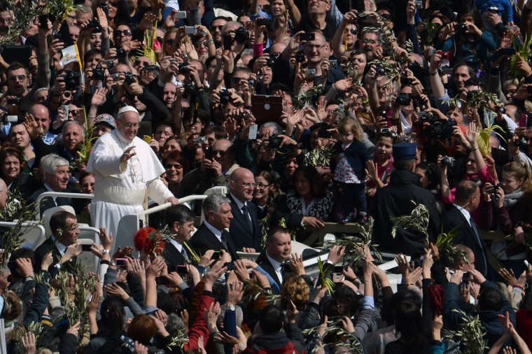 Pope Francis waves to the crowd from the papamobile after a mass on St Peter's square as part of the Palm Sunday celebration on March 24, 2013 at the Vatican. The Palm Sunday marks the start of the holy week of Easter in celebration of the crucifixion and resurrection of Jesus Christ. (Filippo Monteforte/AFP/Getty Images)