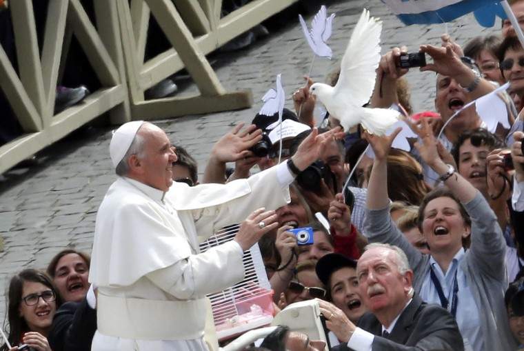 Pope Francis holds a dove before his Wednesday general audience at San Peter's square at the Vatican May 15, 2013. (REUTERS/Stefano Rellandini)