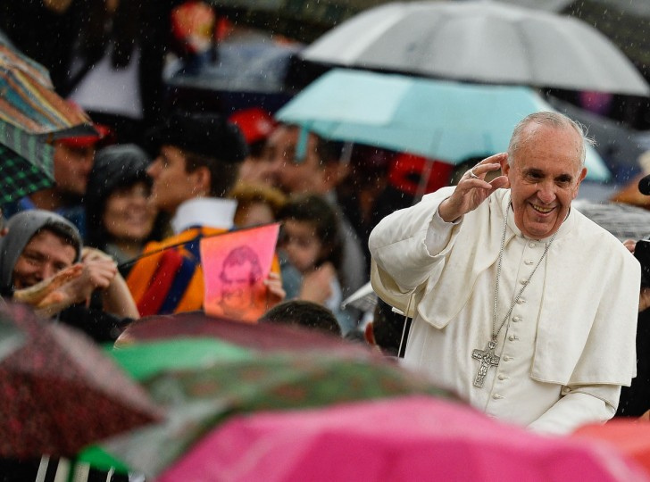Pope Francis waves to the crowd on May 29, 2013 as he arrives for his weekly general audience in St Peter's square at the Vatican. (Andreas Solaro/AFP/Getty Images)
