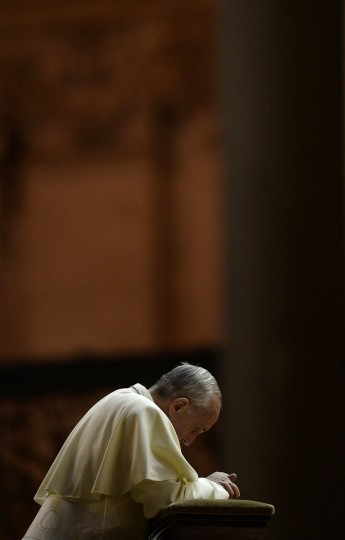 Pope Francis prays in Saint Peter square at the Vatican on September 7, 2013. Pope Francis has called for a global day of fasting and prayer on Saturday for peace in Syria and against any armed intervention. Filippo Monteforte/AFP/Getty Images)