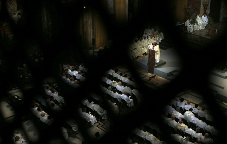 Pope Francis conducts a mass at the Church of the Most Holy Name of Jesus in downtown Rome January 3, 2014. (REUTERS/Alessandro Bianchi)