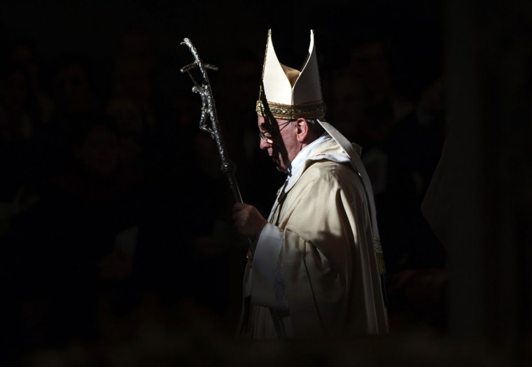 Pope Francis walks with his pastoral staff as he leads the Epiphany mass in Saint Peter's Basilica at the Vatican January 6, 2014. (REUTERS/Max Rossi)