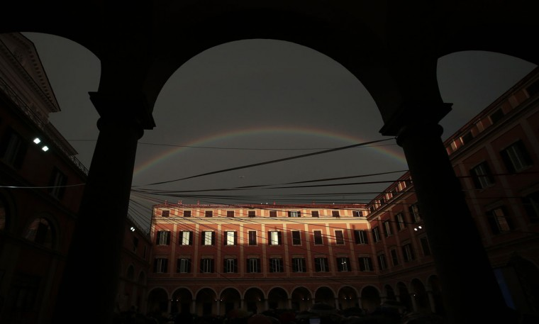 A rainbow is seen over a courtyard as Pope Francis attends a pastoral visit at the Sacro Cuore Basilica in downtown Rome January 19, 2014. (REUTERS/Tony Gentile)
