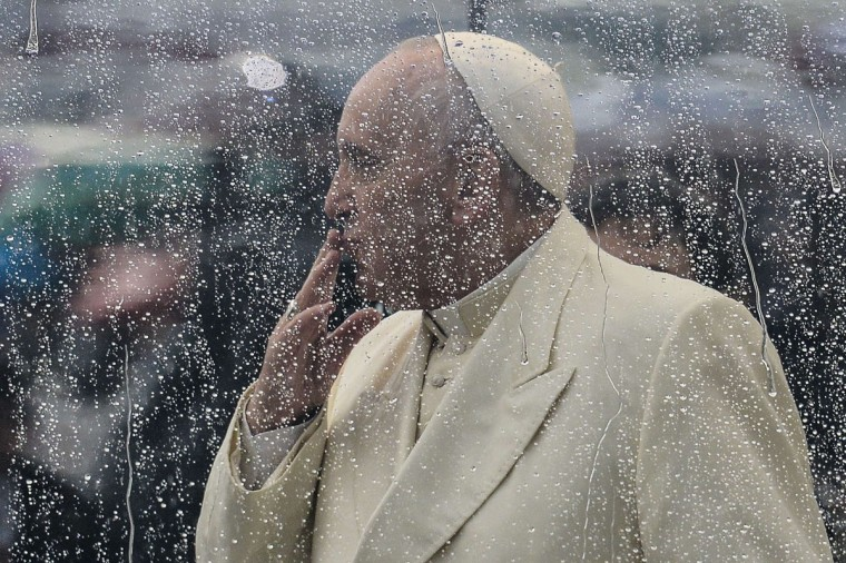 Pope Francis blows a kiss to pilgrims gathered at Saint Peter's square in the Vatican, upon his arrival to lead the general weekly audience on February 5, 2014. (Vincenzo Pinto/AFP/Getty Images)