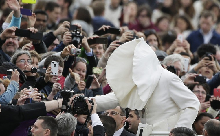 A gust of wind blows Pope Francis's mantle as he arrives to lead his Wednesday general audience in Saint Peter's square at the Vatican February 19, 2014. (REUTERS/Max Rossi)
