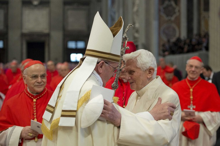 Pope Francis (L) greets Pope Emeritus Benedict XVI during a consistory ceremony in Saint Peter's Basilica at the Vatican February 22, 2014. Pope Francis urged 19 freshman cardinals to shun rivalries and factions at an induction ceremony on Saturday where his scandal-plagued predecessor, pope Benedict, made a surprise appearance. (REUTERS/Osservatore Romano)