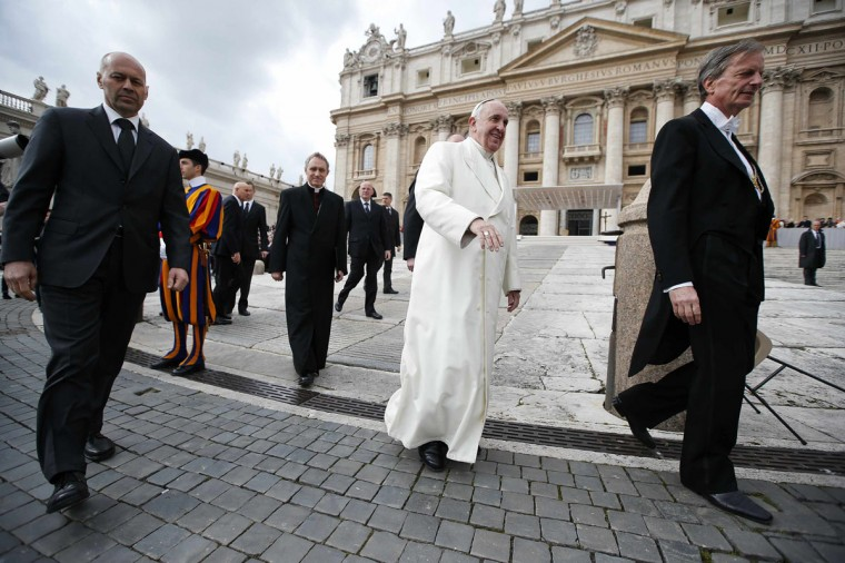Pope Francis leaves at the end his Wednesday general audience in Saint Peter's square at the Vatican February 26, 2014. (REUTERS/Tony Gentile)
