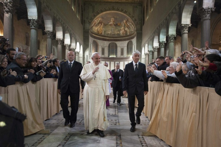Pope Francis leaves after celebrating the Ash Wednesday mass at the Santa Sabina Basilica in Rome, March 5, 2014. (REUTERS/Osservatore Romano)