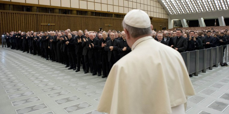 Pope Francis stands during a meeting with priests of Rome during a meeting at Paul VI's Hall at the Vatican March 6, 2014. (REUTERS/Osservatore Romano)