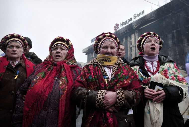 "Ukrainian woman in traditional costumes sing their national anthem in Independence square in central Kiev on March 1, 2014. Ukraine accused Russia on March 1, 2014 of sending thousands of extra troops into Crimea as the Kremlin vowed to help restore calm on the flashpoint peninsula and Washington warned of ""costs"" to Moscow should it use force. (Louisa Gouliamak/AFP/Getty Images)"